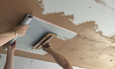 plastering the heating film into the skim